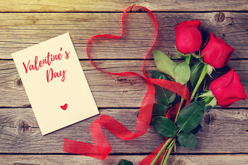 Red roses and Valentine's day card