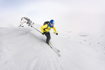 Man enjoying skiing off piste on a bright day