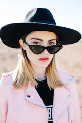 Stylish girl in hat and sunglasses