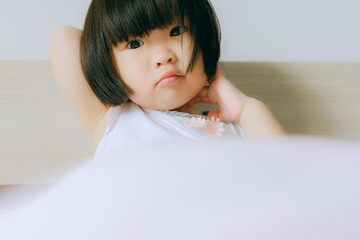 cute little girl on bed