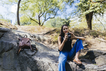 Young Girl With a Vintage Film Camera In Central Park. New York