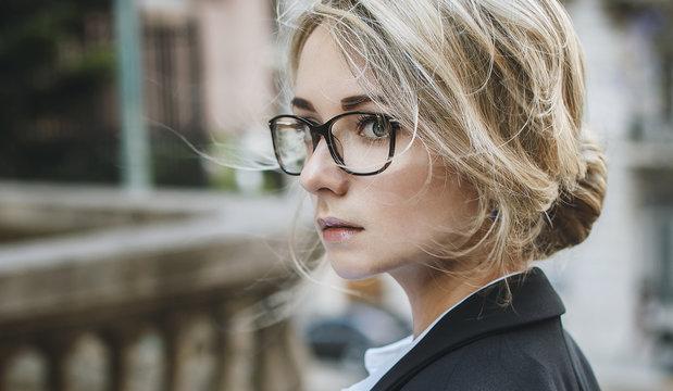 Portrait of beautiful blonde woman in glasses