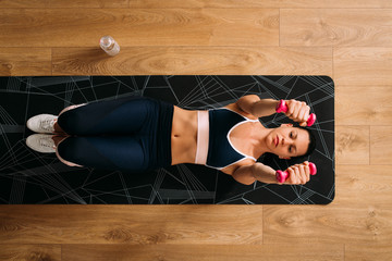 Woman doing soft workout on floor
