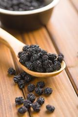 Dried chokeberries. Black aronia berries.