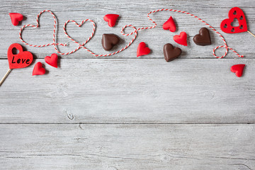 Wooden background with red hearts for Valentines Day