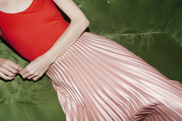 woman with pink pleated skirt