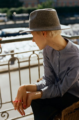 Young woman wearing grey hat looking away