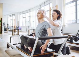 Physiatrist Doing Training With Patient