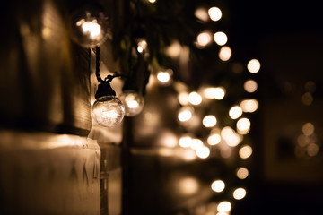 Light bulb hang in bokeh background, concept of interior and design in your work