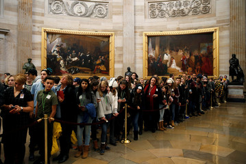 Students wait for U.S. Vice President Mike Pence to pass through the Rotunda on Capitol Hill in Washington