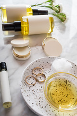 Beauty and care products over marble plate