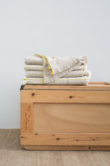 Stack of wool blankets, wooden box and carpet