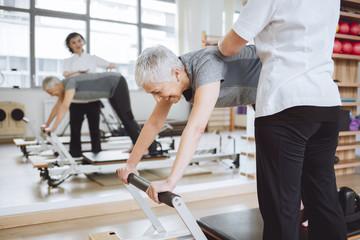 Senior Woman Doing Spine Exercise
