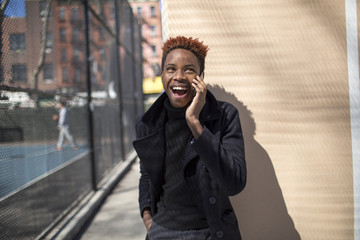 Young black man on a cellphone.