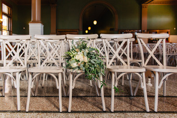 Wedding bouquet on chairs in an old train station.