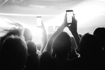 People listen to the concert and take pictures on the phone