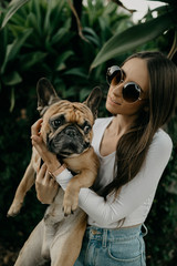 Young Woman and French Bulldog Dog Outdoors