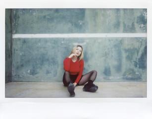 Pretty woman sitting on concrete ground