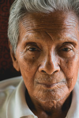 Asian old man sitting on chair