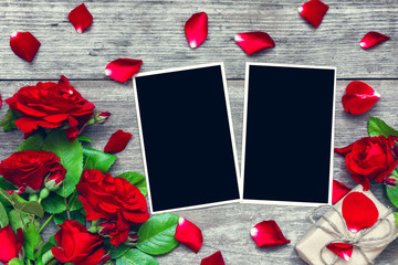 valentines day background. blank photo frames with red rose flowers bouquet and gift box