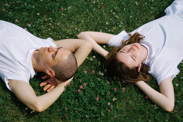Young couple lying on the grass