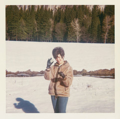 Woman holding a snowball in Yosemite -1967