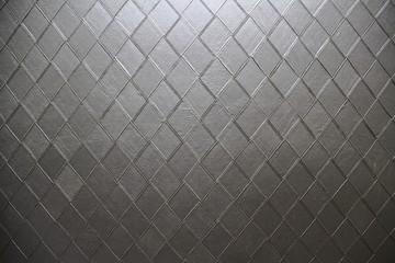 Background image consisting of diamond shape leather.