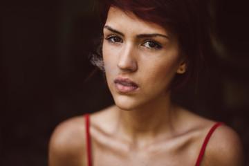 Portrait of a woman enjoying cigarette