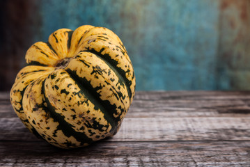 Green and Yellow Sweet Dumpling Squash on wooden table with copy space