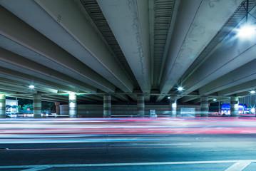 light trails of cars through overpass