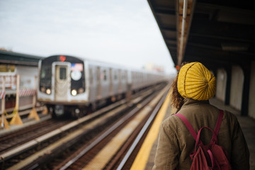 Young woman waiting for a train in New York subway