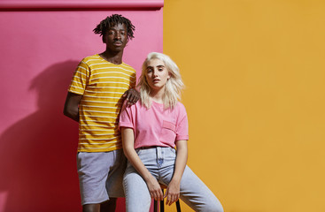Young multiracial couple on a colourful background