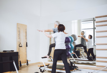 Woman Doing Fitness Exercise With Therapist
