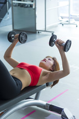 One young asian woman work out in the gym