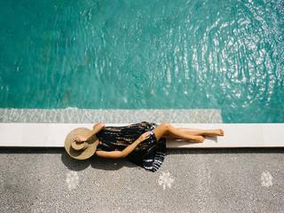 Female lying near pool