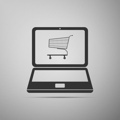 Online shopping concept. Shopping cart on screen laptop icon isolated on grey background. Concept e-commerce, e-business, online business marketing. Flat design. Vector Illustration