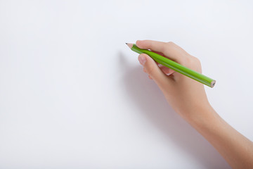 The child's hand with a pencil