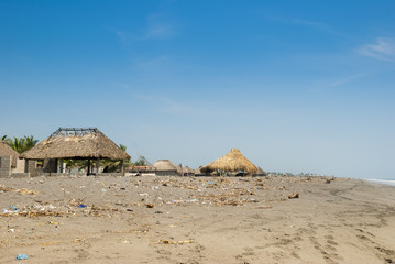 Playa Tauexco in suchitepequez, poor ranch surrounded by trash, public beach in Guatemala.