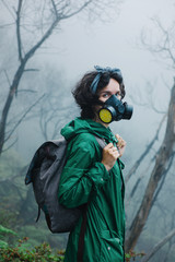 Female in mask walking on volcano