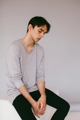 Young handsome brunet man posing at studio