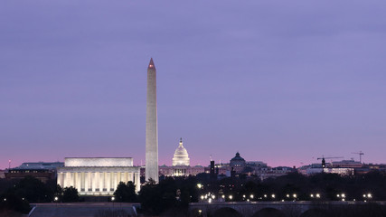 Sunrise, Lincoln Memorial, Washington Monument, and Capitol dome in Washington DC.