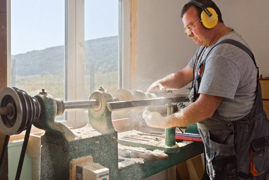 Side view of man working in carpentry workshop