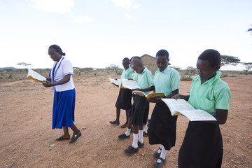 Teacher with school girls.