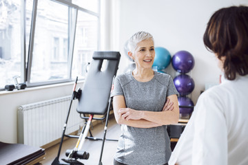 Woman Patient Talking With Doctor at Gym