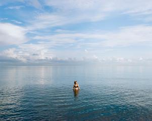 Female swimming alone