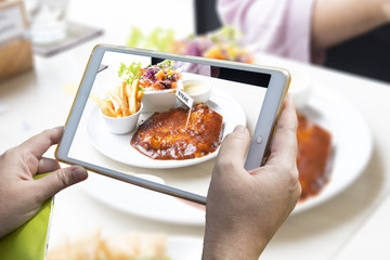 Using smartphone to take food photo.