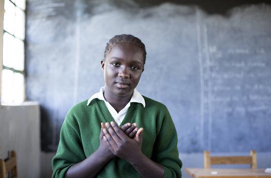 Deaf school children learning sign language