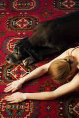 Female and dog on floor
