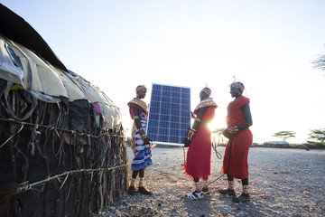 Samburu women with solar panel. Kenya.