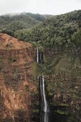 Waterfalls in Waimea Canyon helicopter images in Kauai Hawaii